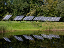 Solar Panels. This image of the solar panels reflected in the pond was taken in the Canterbury area of central New Hampshire Royalty Free Stock Photography