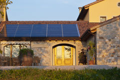Solar panels. Some solar panels on the roof of a rustic house stock photos