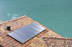 Solar Panels. Used as a source of energy for this house near a lake Royalty Free Stock Photos