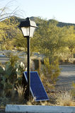 Solar Panels. Used in the desert to provide electricity for lighting in a parking lot Royalty Free Stock Image