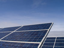 Solar panels. Blue solar panels in front of blue sky Royalty Free Stock Photo
