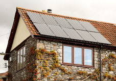 Solar panels. Domestic house roof with solar panels for electricity Royalty Free Stock Photo