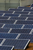 Solar panels. Close up of rows of solar panels on building roof Stock Photos