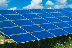 Solar panels against a blue sky Royalty Free Stock Images