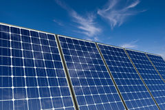 Solar panels against a blue sky royalty free stock image