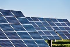 Solar panels against blue sky background Royalty Free Stock Photo