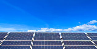 Solar panels against blue sky Stock Image