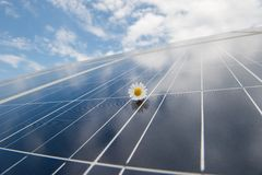 Solar Panels against blue sky. Solar panels against cloudy blue sky with a white flower above Stock Image