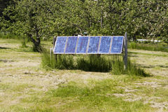 Solar Panels Against Green Background Royalty Free Stock Image