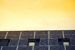 Solar panels against yellow sky Stock Photography