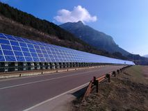 Solar panels along road highway. Solar panels along road or highway Royalty Free Stock Photography