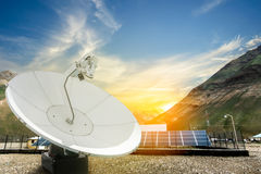 Solar panels, antenna booster with sun rise Royalty Free Stock Photography