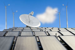 Solar panels, antenna booster and wind turbine Stock Photography
