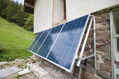 Solar panels on apline hut Stock Photography