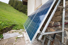 Solar panels on apline hut Stock Image