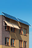 Solar panels attached on the front of a new house Royalty Free Stock Photography