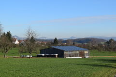 Solar panels on barn. Some solar cells or panels on a barn stock photo