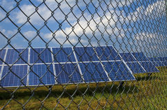 Solar panels behind rusty fence. In the field near Sofia Royalty Free Stock Images