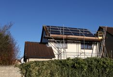Solar panels being installed on a generic house royalty free stock images