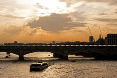 Solar Panels on Blackfriars Bridge in London. A boat on the River Thames passes below Blackfriars Bridge in London. The bridge has installed 4,400 solar panels Stock Images