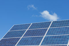 Solar panels on a blue sky Royalty Free Stock Image