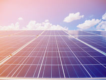 Solar panels with blue sky and clouds. Solar energy environmentally friendly green energy Stock Photo