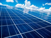 Solar panels with blue sky and clouds. Solar energy environmentally friendly green energy Stock Photos