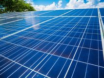 Solar panels with blue sky and clouds. Solar energy environmentally friendly green energy Royalty Free Stock Image