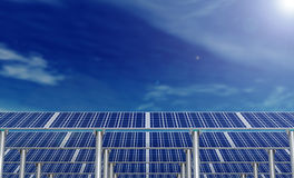 Solar panels and blue sky with clouds and sun flare Stock Photo