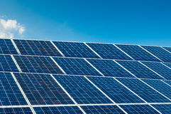 Solar panels on blue sky with copy space Royalty Free Stock Images