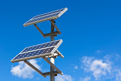 Solar panels on bright blue sky background Royalty Free Stock Photography
