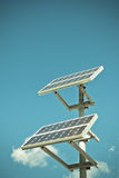 Solar panels on bright blue sky background Royalty Free Stock Image