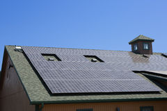 Solar panels on a brown house Royalty Free Stock Images
