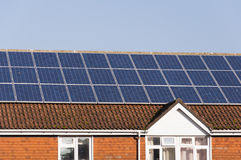 Solar panels on building roof royalty free stock photography