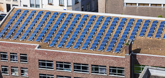 Solar panels on building roof. Solar panels on the roof of administrative building Royalty Free Stock Photos