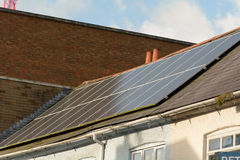 Solar panels on building roof Stock Photography