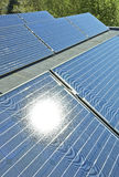 Solar Panels on a Building Roof. With sun in reflection Stock Image