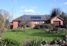 Solar Panels on Bungalow Roof. 16 Solar Panels on Bungalow Roof in UK Royalty Free Stock Photography
