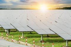 Solar panels solar cell in solar farm with blue sky and sun li stock photos