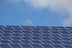Solar panels cells. Solar cells on a roof of the building Stock Image