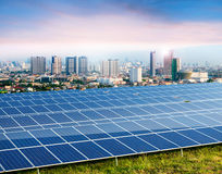 Solar panels, cityscape on background. Solar panels, city on background Stock Images
