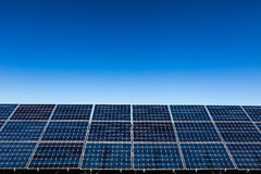 Solar panels and clear sky background Stock Photos