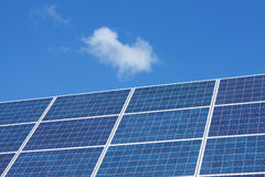 Solar panels and clouds Royalty Free Stock Photos