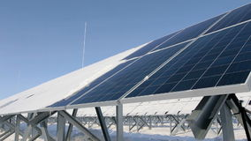 Solar panels on a cold sunny day close-up pan left stock video footage