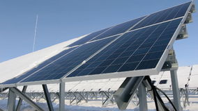 Solar panels on a cold sunny day close-up stock video