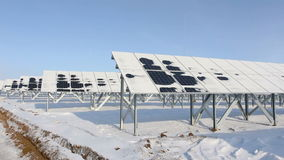 Solar panels on a cold sunny day perspective view pan left stock video
