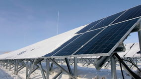 Solar panels on a cold sunny day stock video