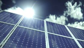 Solar panels or collectors in front of blue sky with clouds in sunlight. Solar panels or solar collectors heading towards the sky in front of blue sky with Stock Photos