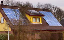 Solar panels on a colorful house Stock Photos