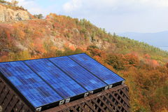 Solar panels on colorful mountainside Stock Images